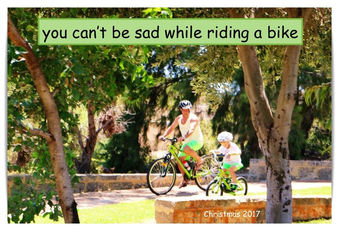 christmas green shorts kev and finn on bike